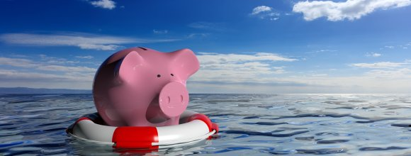 Lifebuoy and a piggy bank on blue sea background. 3d illustration